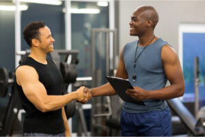 smiling trainer and client