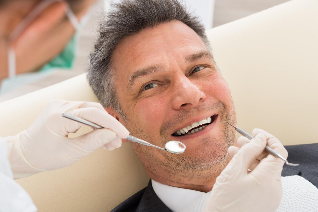 man at this regular check up at the dentist