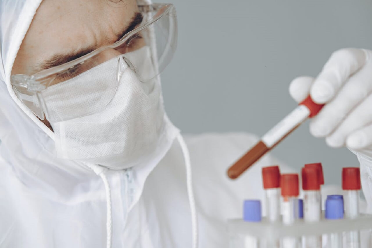 clinical pathologist with specimens