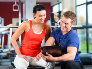 personal trainer teaching a client